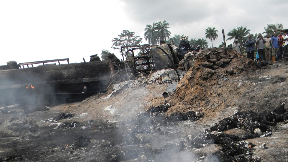 People look at the aftermath of a fuel tanker explosion in Okogbe, Nigeria, Thursday, July 12, 2012. (AP)