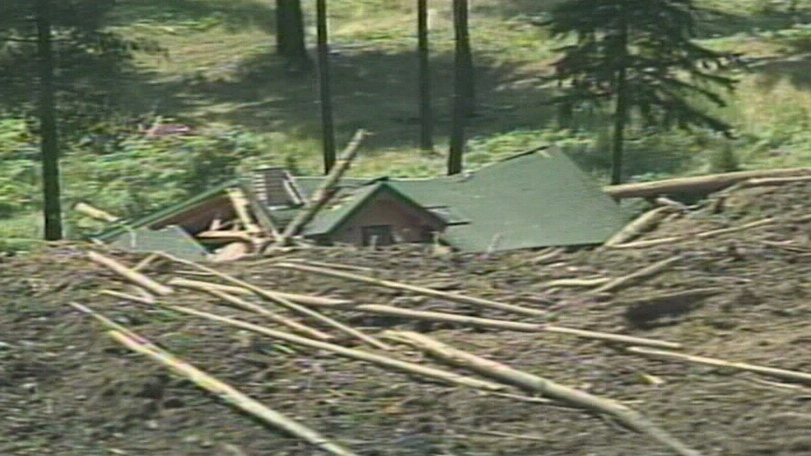 A house is shown after it was buried in a landslide near Johnsons Landing, B.C. on Thursday, July 12, 2012.
