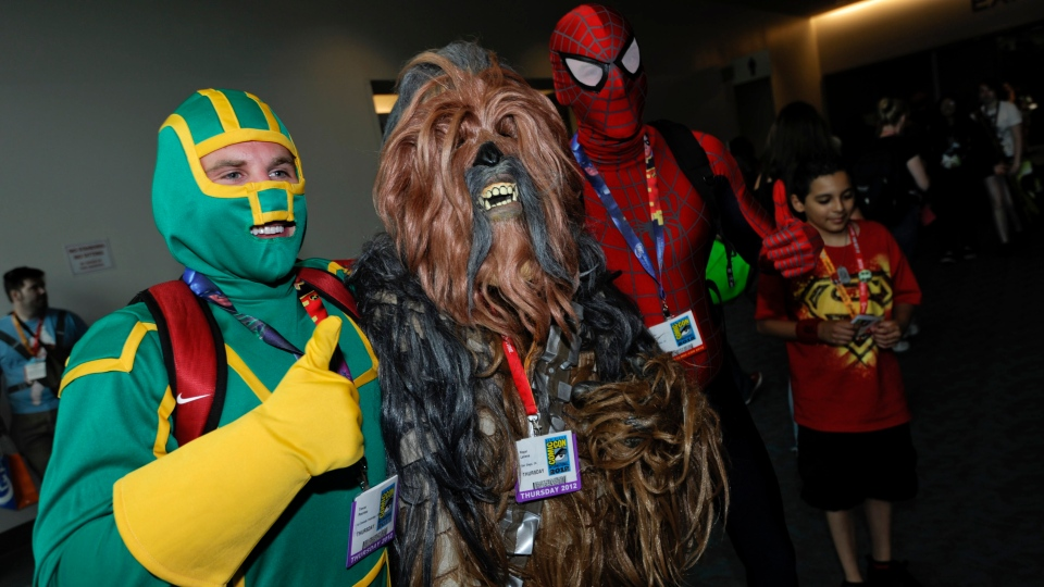 Characters pose photos on first day of Comic-Con convention held at the San Diego Convention Center on Thursday, July 12, 2012, in San Diego. (AP / Denis Poroy / Invision)