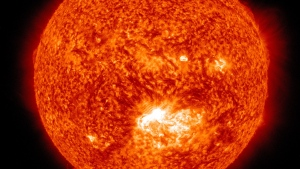 This image captured in the 304 Angstrom wavelength, which is typically colorized in red provided by NASA shows a solar flare, lower center, erupting from the sun on Thursday, July 12, 2012. (NASA)