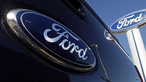 This Oct. 25, 2011 file photo shows a Ford logo on the tailgate of a pick-up truck at a dealership i