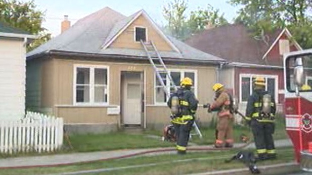 Firefighters extinguish a blaze on Polson Avenue, Thursday morning. (file image)