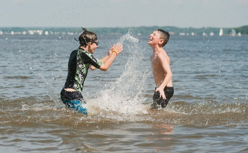 Evan Buddle, 11, left, and Christopher Mailloux, 10, cool down in the Lake of Two Mountains west of Montreal, Friday, July 22, 2011. (Graham Hughes / THE CANADIAN PRESS)