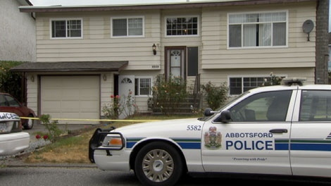 Police investigate at an Abbotsford home where Amarjit Kau Khosa was found dead. July 21, 2010. (CTV)