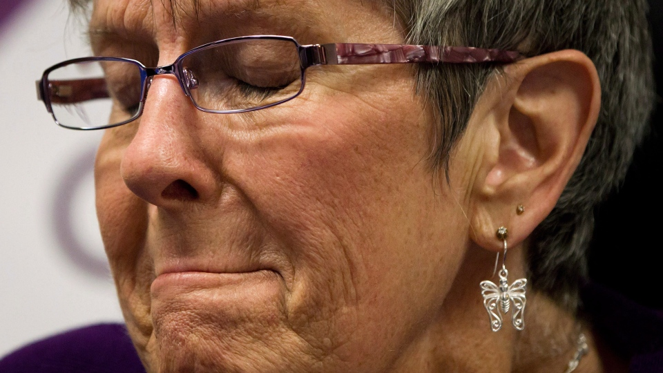 Gloria Taylor, who suffers from Lou Gehrig's disease and won a doctor-assisted suicide challenge in B.C. Supreme Court, pauses during a news conference in Vancouver, B.C., on Monday June 18, 2012. (Darryl Dyck / THE CANADIAN PRESS)