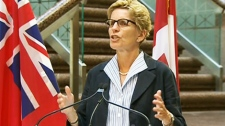 Minister of Transportation Kathleen Wynne speaks to the media in Toronto on Monday, July 26, 2010.