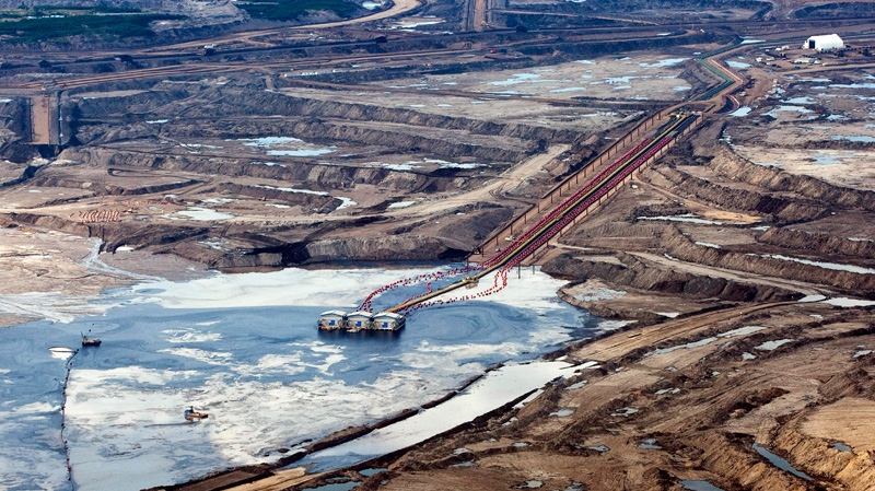 Oil sands facility seen from a helicopter near Fort McMurray, Alta.