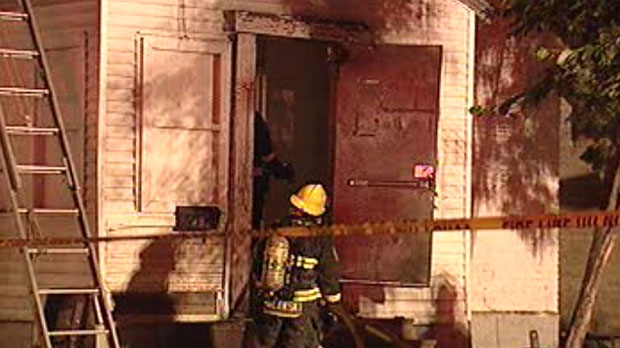 Fire crews work to extinguish a blaze in a rooming house on Euclid Avenue Friday night.