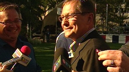 Premier Ed Stelmach speaks to reporters during his annual pancake breakfast on Tuesday, July 27, 2010.