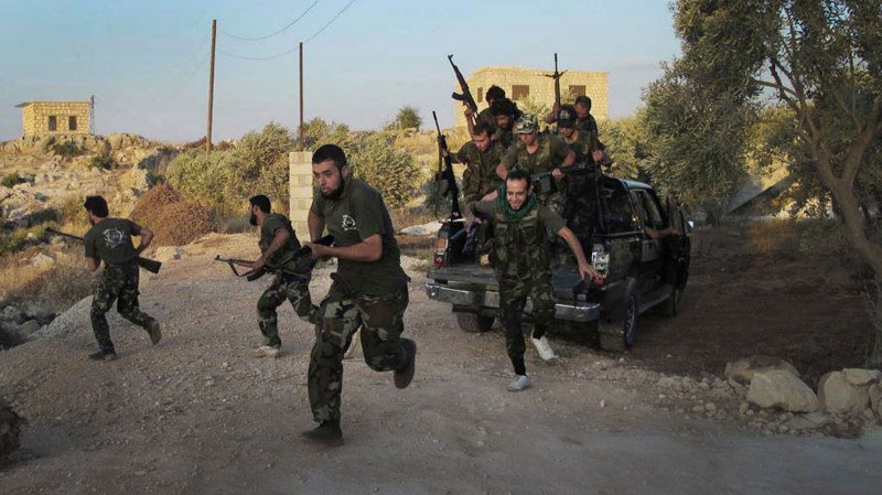Free Syrian Army soldiers run for cover in Idlib province, northern Syria on Friday, July 13, 2012. (AP / Edlib News Network ENN)