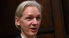 Founder and editor of the WikiLeaks website, Julian Assange, faces the media during a debate event, held in London Tuesday, July 27, 2010. (AP / Max Nash)