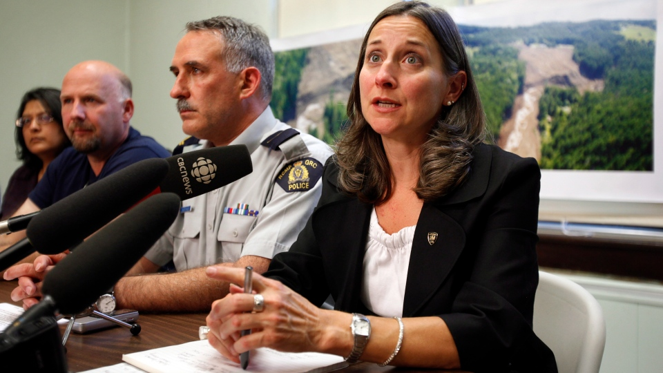 B.C. Chief Coroner Lisa Lapointe, right, confirms to the media that the search has recovered a body and has now changed to a recovery operation in Kaslo, B.C., Sunday, July 15, 2012. (Jeff McIntosh / THE CANADIAN PRESS)