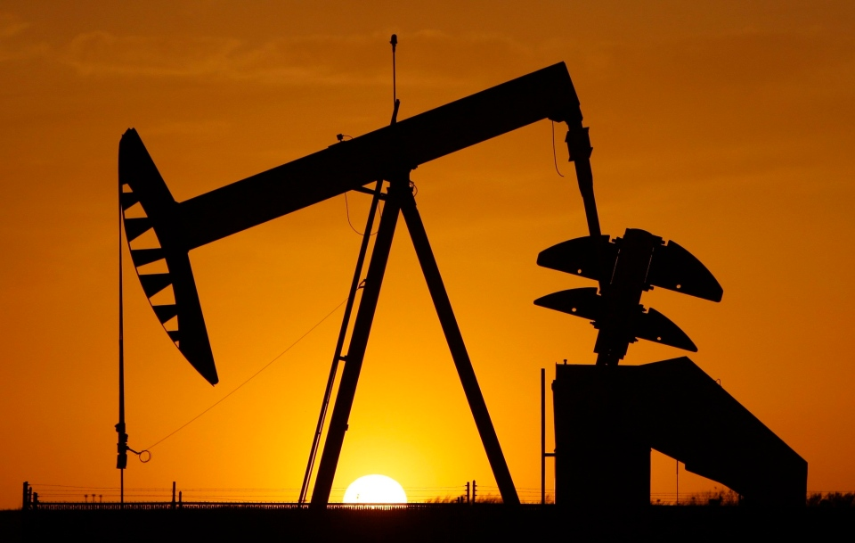 A pump jack is silhouetted against the setting sun in Oklahoma City, on March 22, 2012. (Sue Ogrocki / AP)