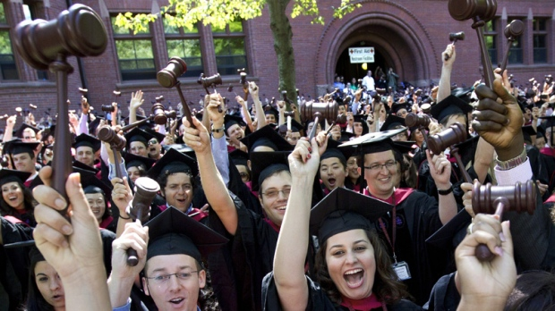 Graduates of Harvard Law School cheer during commencement exercises on May 24, 2012.