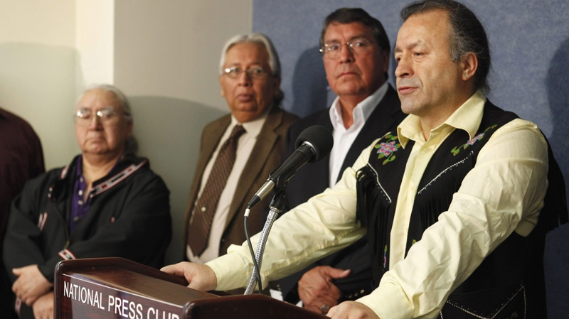 Dene National Chief Bill Erasmus, right, shares concerns about the Keystone XL Pipeline at a press conference in Washington on Dec. 1, 2011. (AP Photo/Jacquelyn Martin)