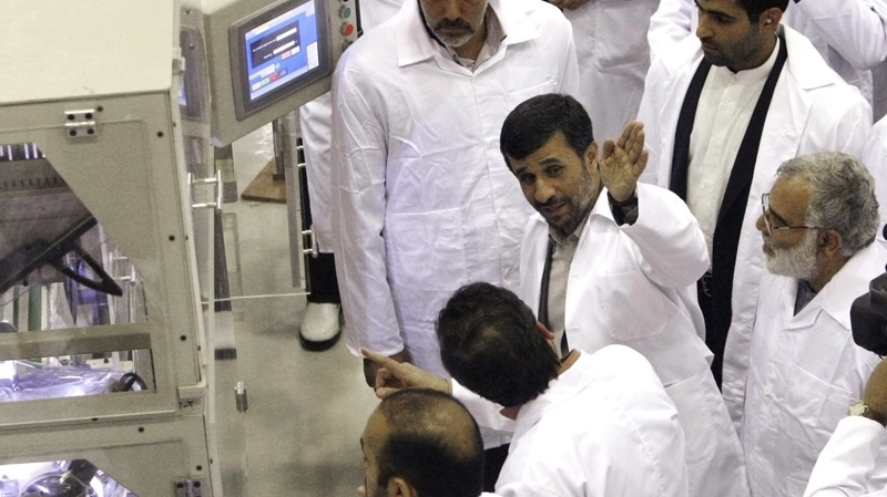 Iranian President Mahmoud Ahmadinejad, second right, gestures as he visits Iran's Fuel Manufacturing Plant (FMP), a facility producing uranium fuel just outside the city of Isfahan, Iran, on April 9, 2009. (AP Photo/Vahid Salemi, File)