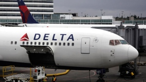 A Delta Airlines Inc. plane sits on the tarmac at Seattle-Tacoma International Airport in Seattle, on Monday, June 7, 2010.  (AP / Ted S. Warren)