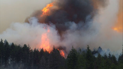 The Yalakom wildfire burning northwest of Lillooet, B.C., is seen on July 27, 2010. It is burning approximately two hours west of Kamloops, where as many as 150 residents have been forced out of their homes by a wildfire burning on the eastern edge of the city.