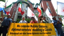 Members of the Iranian-Canadian community in Ottawa demonstrate outside the Iranian embassy