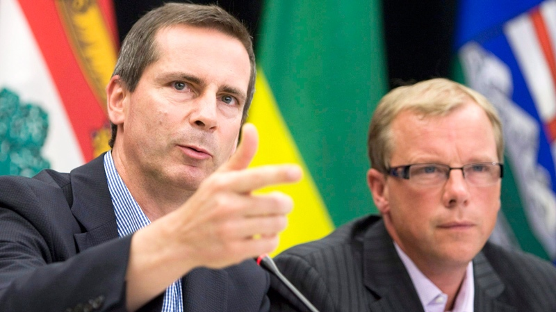Ontario Premier Dalton McGuinty, left, and Saskatchewan Premier Brad Wall speak to media following meeting of the Council of the Federation in Regina, Sask., Friday, Aug. 7, 2009. (Geoff Howe / THE CANADIAN PRESS)