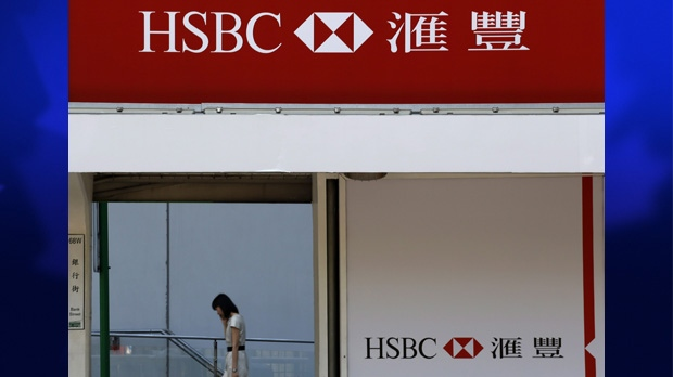 A woman walks past the HSBC's Hong Kong headquarters on May 8, 2012.