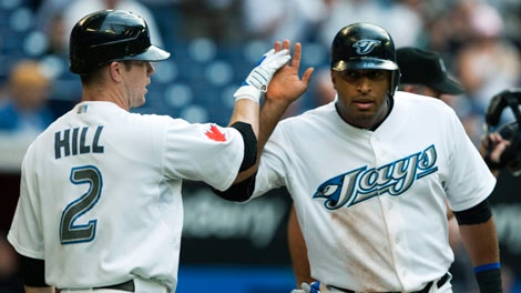 Toronto Blue Jays second baseman Aaron Hill, left, celebrates with Blue Jays centre fielder Vernon Wells, right, during second inning AL action in Toronto on Wednesday, July 28, 2010. (Nathan Denette / THE CANADIAN PRESS)