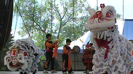 A group performs an ethnic dance at the Heritage Festival at Hawrelak Park in Edmonton.