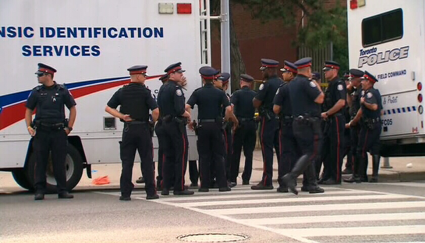 Police investigate the scene of a fatal shooting that killed two and injured 23 people in Scarborough on Tuesday, July 17, 2012.