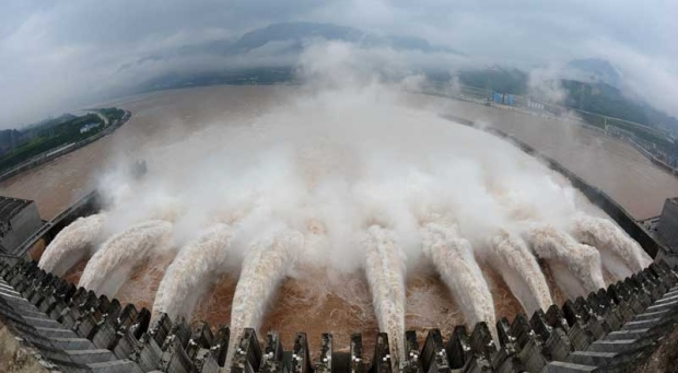 In this photo released by China's Xinhua news agency, flood water is released from the Three Gorges Dam's floodgates in Yichang, in central China's Hubei province, Tuesday, July 20, 2010.(AP Photo/Xinhua, Cheng Min)
