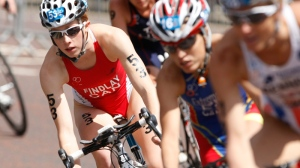 FILE - Paula Findlay of Canada, left, rides in the pack during the cycle stage of the London Triathlon in Hyde Park, London, Saturday, July 24, 2010. (AP / Alastair Grant)
