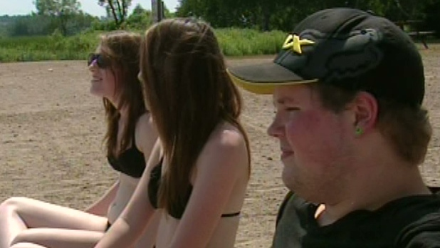 Young people at the beach at Laurel Creek Conservation Area in Waterloo, Ont. on Tuesday, July 17, 2012.