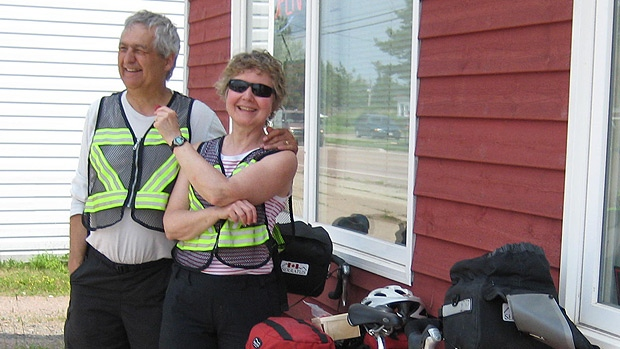 Edmund Aunger and his wife Elizabeth Sovis pose during a stop on July 13 in New Brunswick on their bicycle tour of the Maritimes. Supplied.