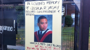 A poster memorializing Joshua Yasay, 23, who was one of two people killed in a shooting in Toronto