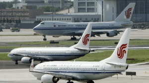 Air China planes sit on the tarmac at Beijing Airport in Beijing, China in this photo taken Aug. 20, 2009. (AP / Greg Baker)