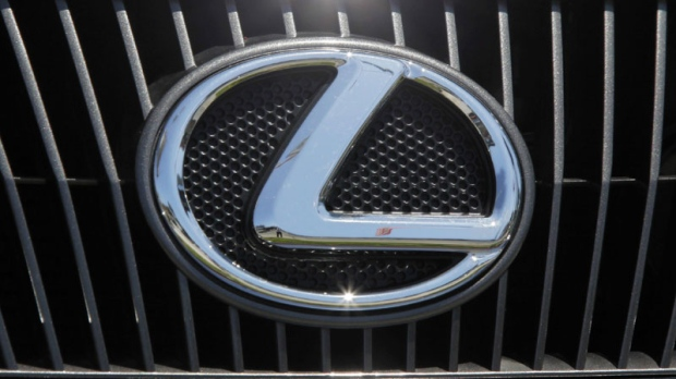 A Lexus nameplate is seen on a car on display at a Lexus dealership in the Woodland Hills area of Los Angeles, Thursday, July 1, 2010. (AP Photo/Reed Saxon)