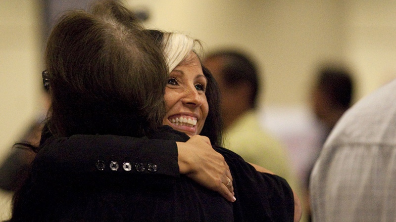 Pamela Palmater hugs a supporter at the AFN AGA in Toronto on July 18, 2012. (THE CANADIAN PRESS/Michelle Siu)