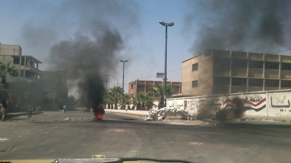 This citizen journalist image shows burning tires in Damascus, Syria, Wednesday, July 18, 2012. (AP Photo)