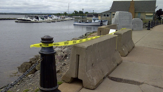 Concrete barriers were installed Wednesday to replace the wooden barricades that once stood at the crash site.