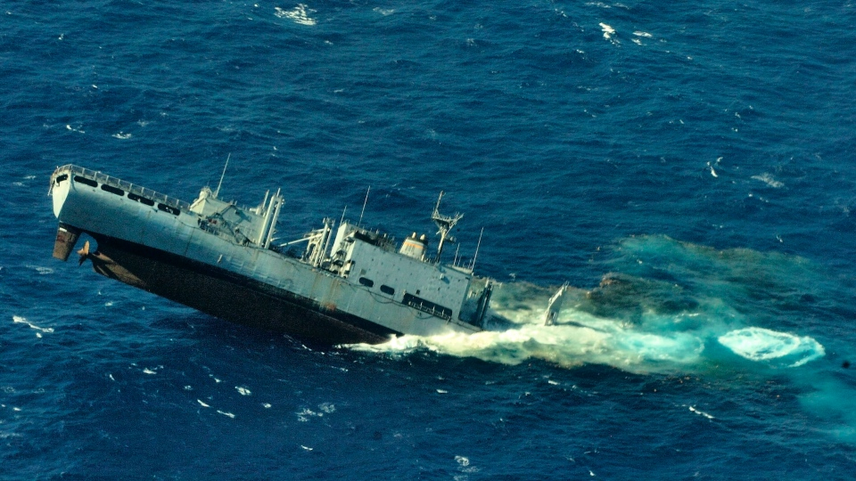 USNS Concord is used as a target vessel for the Canadian submarine HMCS Victoria during a sink exercise at the Pacific Missile Range Facility Barking Sands, in Kauai County, Hawaii, on Tuesday, July 17 2012. (Canadian Forces 407 Long Range Patrol Squadron)