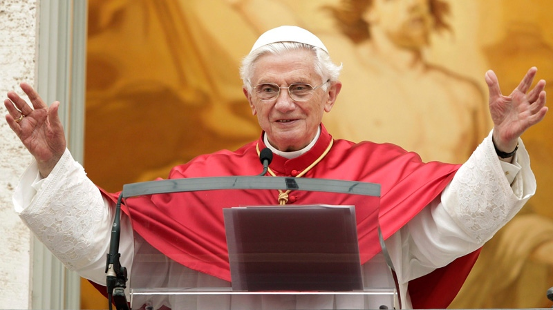 Pope Benedict XVI waves to faithful during the Angelus prayer at his summer residence of Castel Gandolfo, in the outskirts of Rome on Sunday, July 15, 2012. (AP /Riccardo De Luca)