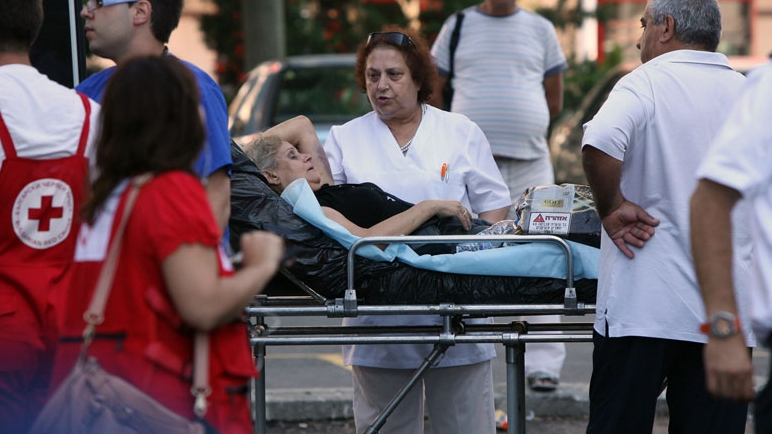 An unidentified injured Israeli tourist is helped as she leaves a hospital in the city of Burgas, Bulgaria, Thursday, July 19, 2012.  (Impact Press Group)