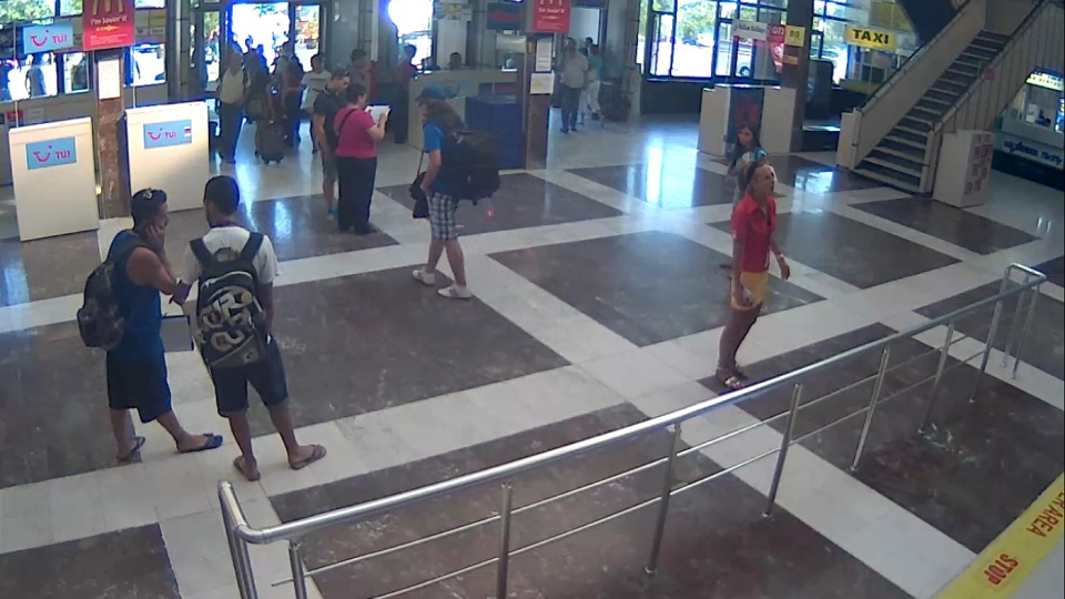 This image taken from CCTV provided by the Bulgarian Interior Ministry who claim it shows the unidentified bomber, centre, with long hair and wearing a baseball cap, at Burgas Airport on Wednesday, July 18, 2012. (Bulgarian Interior Ministry)