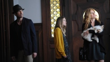 In this image released by FX, from left, Dylan McDermott, Taissa Farmiga and Connie Britton