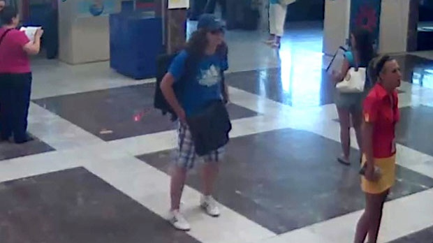 This image made from security video provided by the Bulgarian Interior Ministry on Thursday, July 19, 2012 purports to show the unidentified bomber, centre, with long hair and wearing a baseball cap, at Burgas, Bulgaria airport on Wednesday, July 18, 2012. (AP / Bulgarian Interior Ministry)