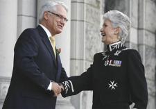 British Columbia Lt.-Gov. Iona Campagnolo shakes hands with Premier Gordon Campbell prior to the Speech from the Throne at the B.C. Legislature in Victoria, Feb. 13, 2007. (CP / Deddeda Stemler)