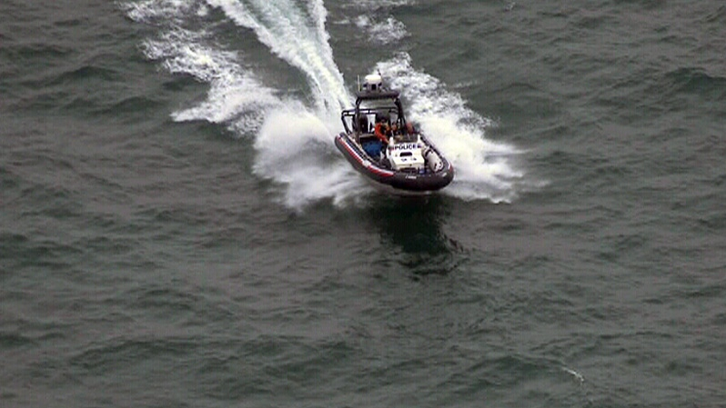 A Toronto Police Marine Unit vessel searches for a man who went missing at Bluffer's Park in Toronto on Thursday, July 19, 2012.