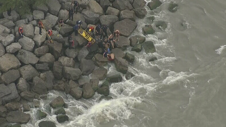 A missing swimmer was pulled from the water in Bluffer's Park in Toronto's east end.