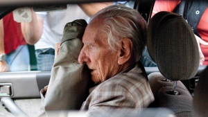 Alleged Hungarian war criminal Laszlo Csatary sits in a car as he leaves the Budapest Prosecutor's Office after he was questioned by detectives on charges of war crimes during WWII and prosecutors ordered his house arrest in Budapest, Hungary, Wednesday, July 18, 2012. (AP / MTI, Bea Kallos)