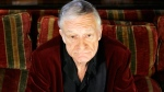Hugh Hefner poses at the Playboy Mansion in Los Angeles on April 5, 2007. (AP / Damian Dovarganes)