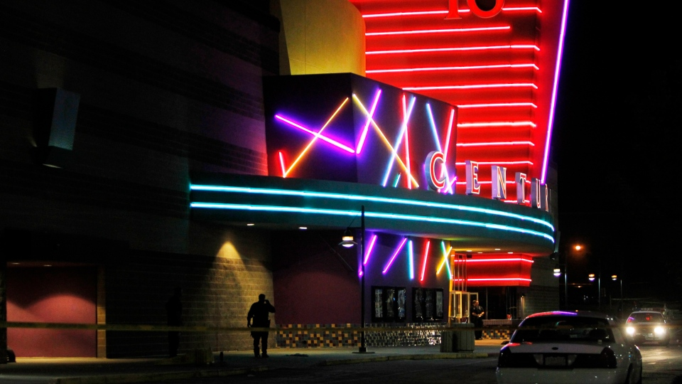 Police outside of a Century 16 movie theatre where as many as 14 people were killed and many injured at a shooting during a midnight screening of 'The Dark Knight Rises' in Aurora, Colo., Friday, July 20, 2012. (AP / Ed Andrieski)
